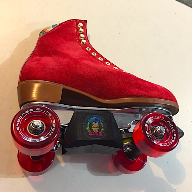 Red Moxi Lolly aggressive roller skates with bigfoot slider blocks.