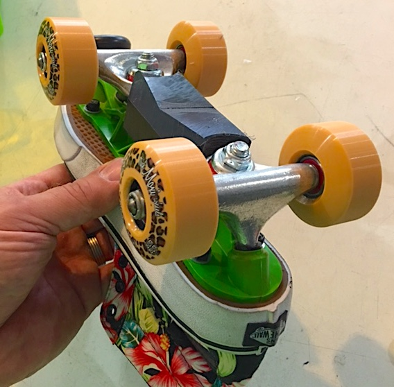 Bigfoot aggressive roller skate plates with Sure Grip ramp trucks and sliders.