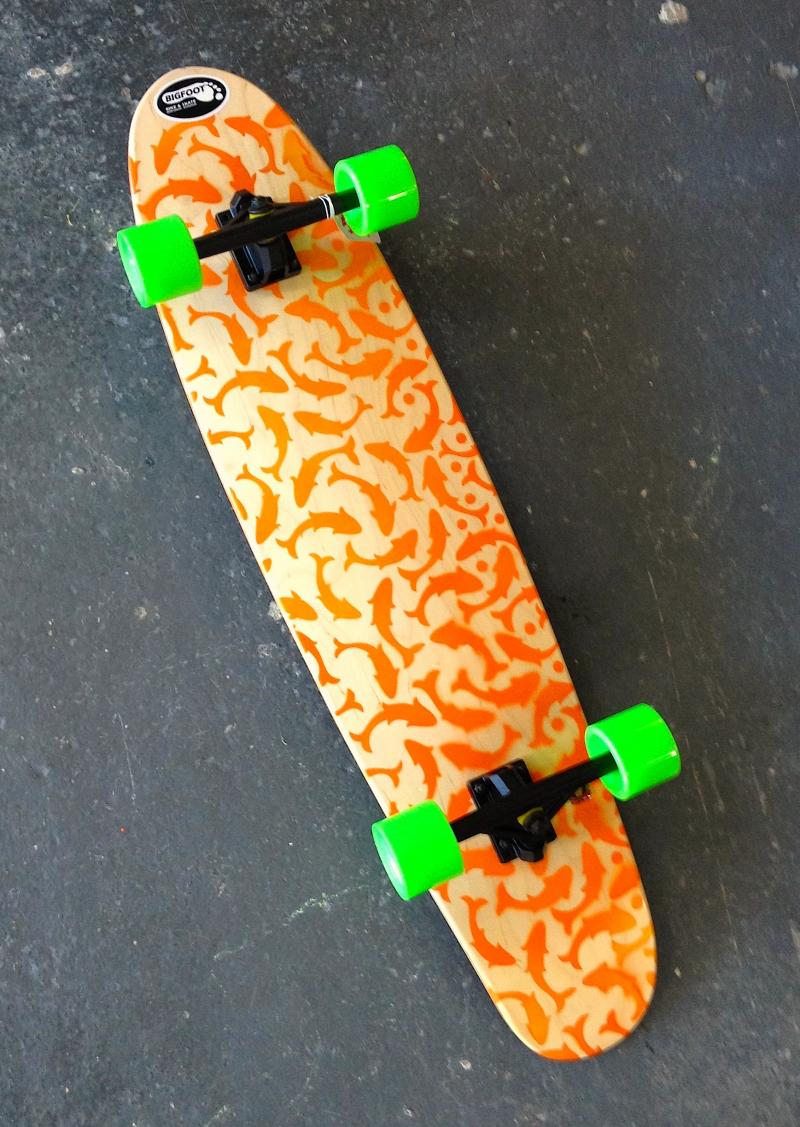 Orange Koi longboard at Bigfoot Bike & Skate, Milwaukee, WI 53207.