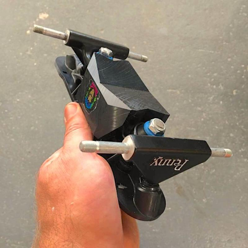 Moxi rollerskates and bigfoot skatepark plate kit with wide trucks and sliders.