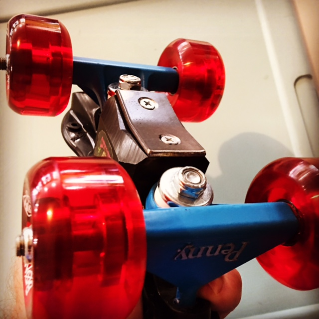 Aggressive roller skates with wide trucks and metal capped slider blocks.
